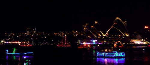 A lit up flotilla in front of The Opera House