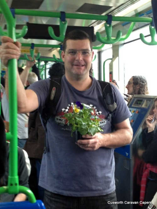 My manly man with his pansy on the tram!
